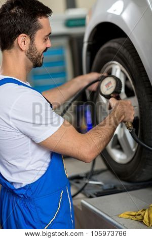 Tire pressure check by car mechanic
