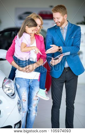 car dealer recommended car for mothers with children at car dealership saloon