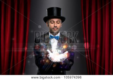 magician holding magic on palm of his hand