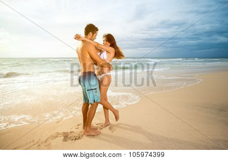 Young affectionate couple on beach
