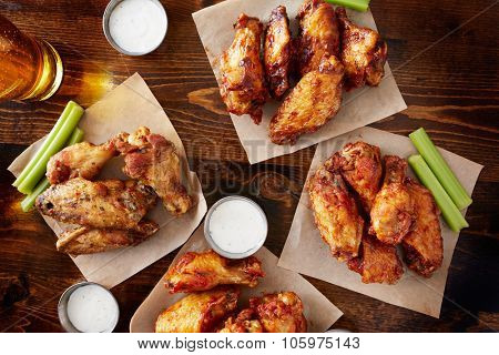 party sampler platter made to share with four different flavors of chicken wings served with beer and ranch dipping sauce