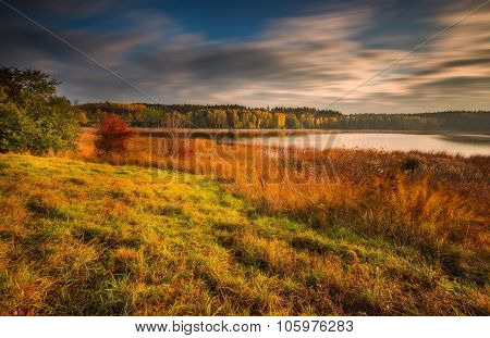 Long Exposure Landscape With Lake At Autumn.