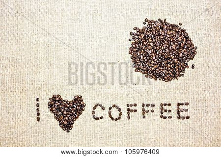coffee beans and mug used to spell love on hessian sack