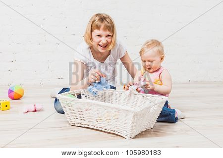 Nice girl laughing sitting nearby her sibling