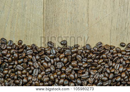 Roasted Coffee Beans On Wood Background