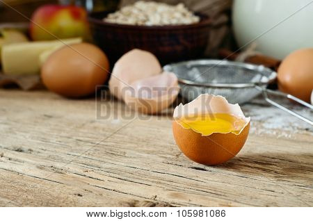 Egg Yolk On A Wooden Table