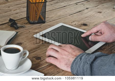 Man Working In Office Using Tablet Computer