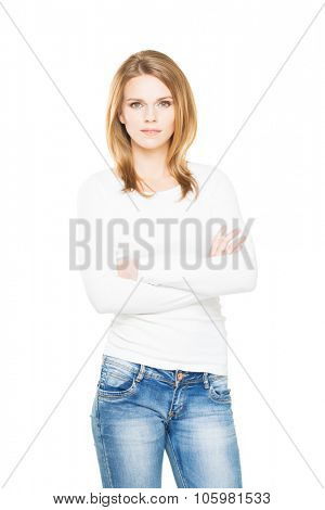 Young and beautiful teenage girl in denim jeans isolated on white