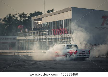 Pick-up Car Perform Burnout Tire On The Track