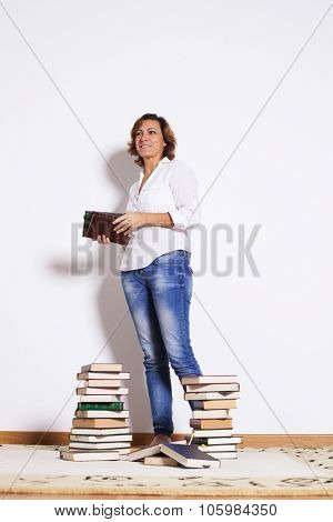 Woman at her house reading books