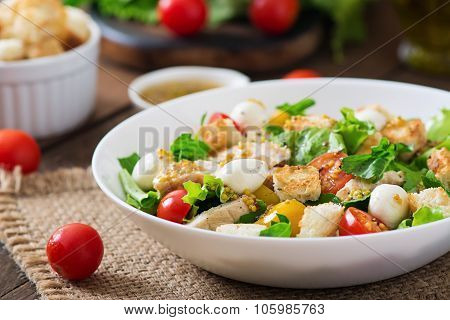 Salad with chicken, mozzarella and cherry tomatoes