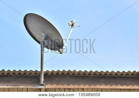 Satellite Dish With Blue Sky On Roof.