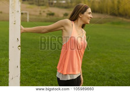 Beautiful woman stretching after finish the exercise