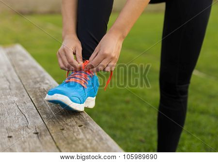 Woman tying her shoes and getting ready for train