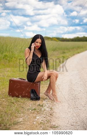 Young Lady Is Talking By Mobile Phone