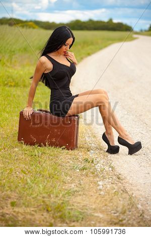 Young Lady Is Waiting Any Car On The Road
