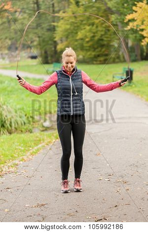 Woman Training On Jumping Rope In Park