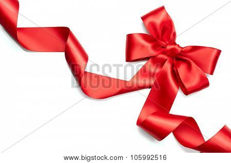 Red satin gift bow. Ribbon Isolated on white background. Elegant Holiday Christmas red silk ribbon