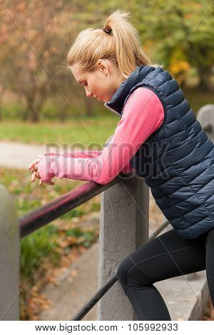 Break During Jogging In A Park
