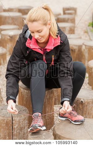 Sportswoman Tied At Break Exercise Shoes