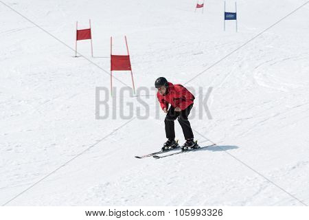 Skier Without Ski Sticks Coming Down The Slope