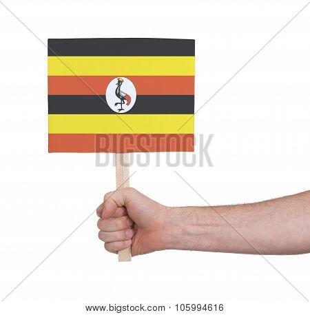 Hand Holding Small Card - Flag Of Uganda