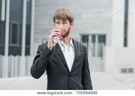 Young Bussinessman And Coffee