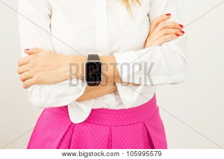 Woman with crossed arms and smartwatch around her wrist