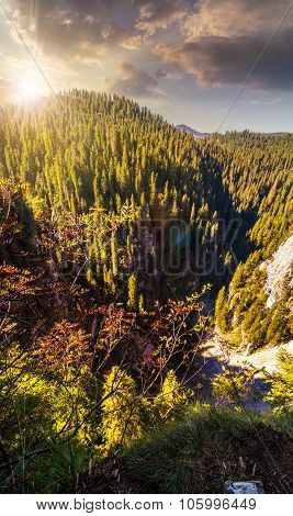Steep Cliff In Romanian Mountains At Sunset