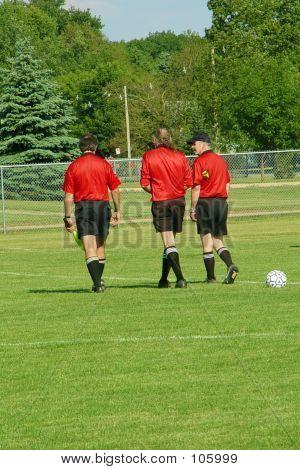 Three Referees Walking Off Field