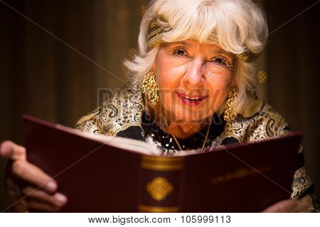 Fortune Teller Holding Magic Book