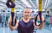������, ������: Man doing suspension training with fitness straps