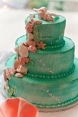 image of three tier  - A blue beach themed wedding cake with three tiers - JPG