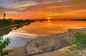 picture of sundarbans  - Brilliant sunrise across a river in Sundarban islands in India - JPG