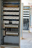 picture of busbar  - new control panels with static energy meters and circuit-breakers (fuse)