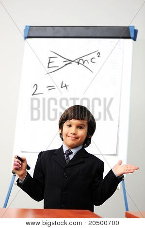 Genius little boy writting E=mc2 on the board, new formula instead, conceptual idea