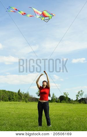 Young Girl In Red Shirt Flying Kite On Summer Meadow