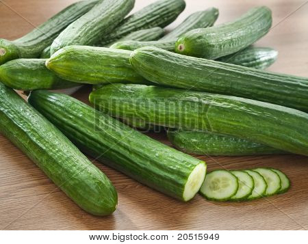 Arrangement of fresh cucumbers on a wooden decks