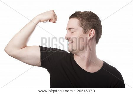 Young man in his 20s looking at biceps