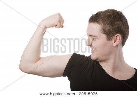 Young man in his 20s flexing biceps