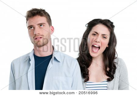 Young man gets earful from an annoyed girl isolated on white background