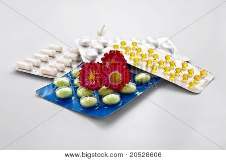 Tablets And Capsules With Daisies