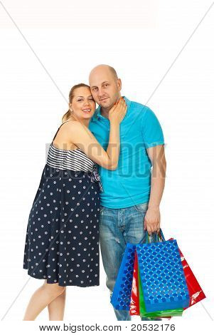Happy Future Parents At Shopping