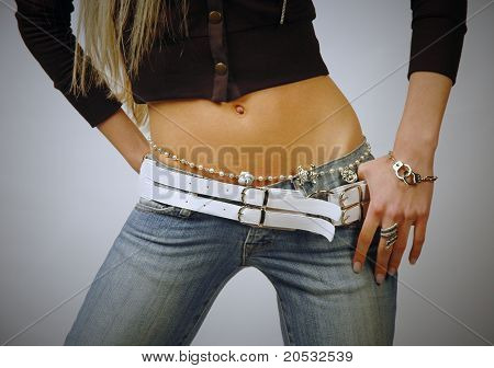 Fit Woman Belly Wearing Jeans And Bijouterie