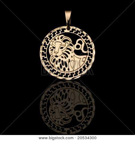 macro of golden pendant on black background