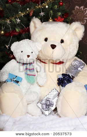 Teddy Bears Sitting At The Christmas Tree