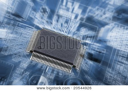 large microchip on a circuitboard, slight zoom effect and in a bluish toning
