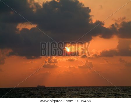 Sunrise With A Ship On Shore