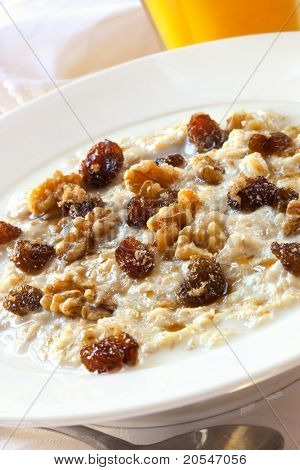 Oatmeal topped with raisins, walnuts and brown sugar.  Delicious healthy porridge.