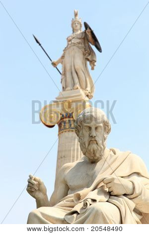 statue of Plato from the Academy of Athens,Greece with the statue of Athena on background